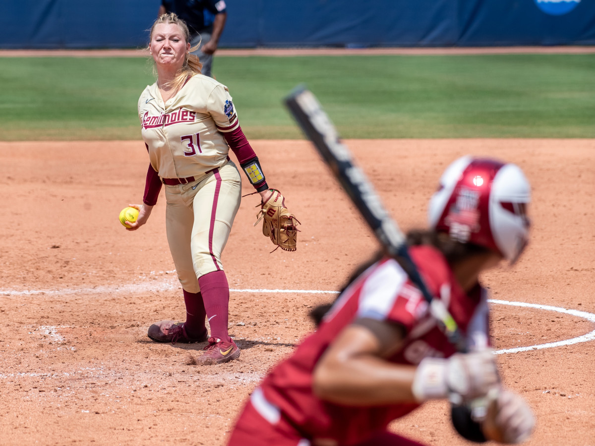 Jun 10, 2021; Oklahoma City, Oklahoma, USA; Florida State Seminoles starting pitcher/relief pitcher Danielle Watson (31) pitches to Oklahoma Sooners during the third inning during game three of the NCAA Womens College World Series Championship Series at USA Softball Hall of Fame Stadium.