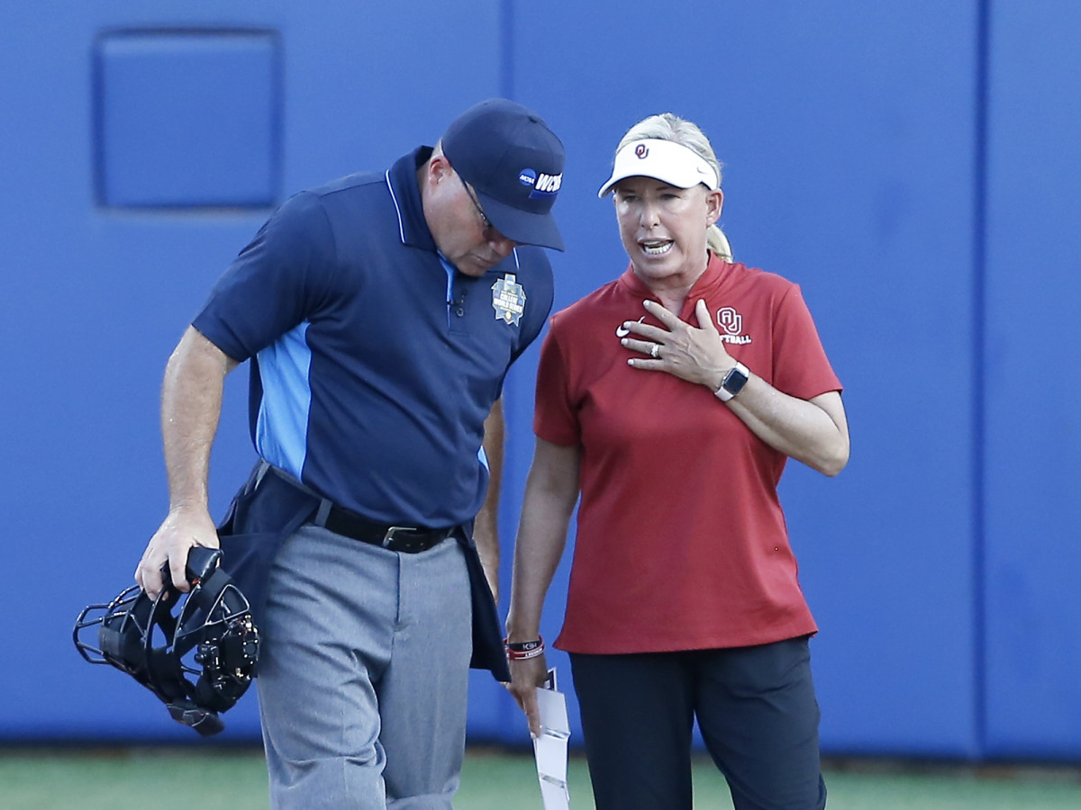 Jun 8, 2021; Oklahoma City, Oklahoma, USA; Oklahoma head coach Patty Gasso talks to the umpire during game one of the NCAA Women's College World Series Championship Series against Florida State at USA Softball Hall of Fame Stadium.