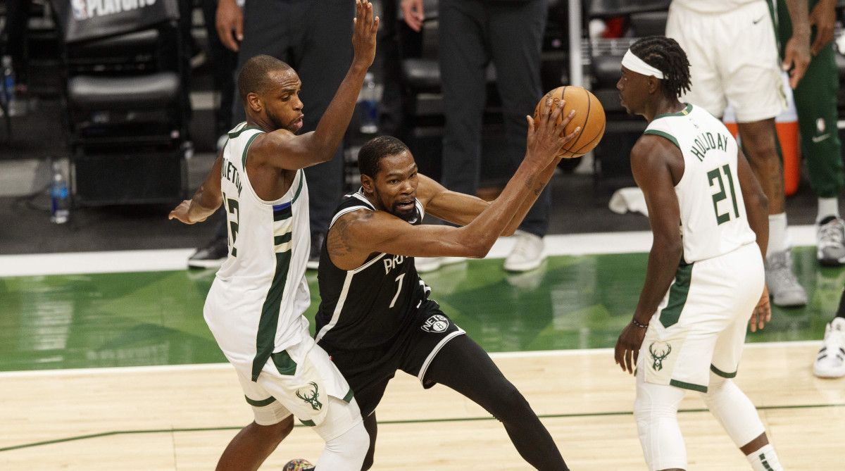Khris Middleton, Kevin Durant and Jrue Holiday