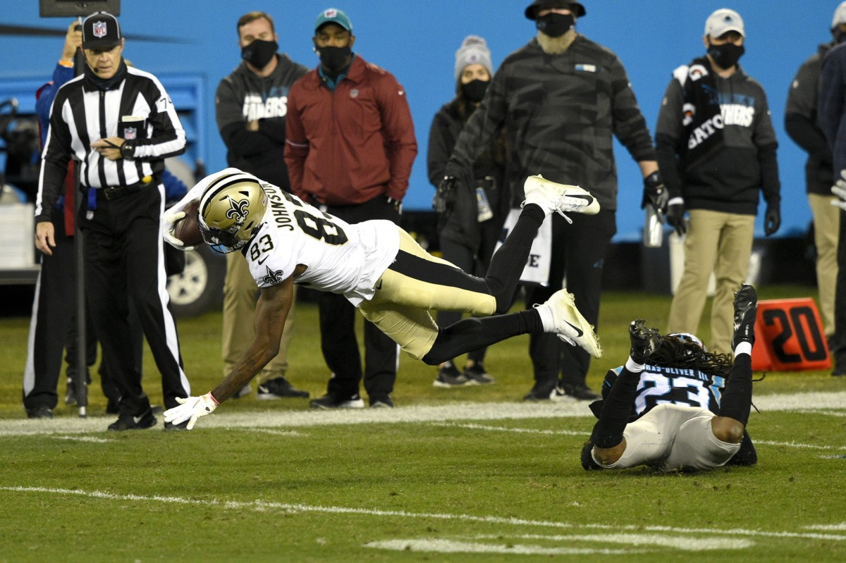 New Orleans receiver Juwan Johnson (83) makes a catch in the fourth quarter at Bank of America Stadium. Mandatory Credit: Bob Donnan-USA TODAY Sports