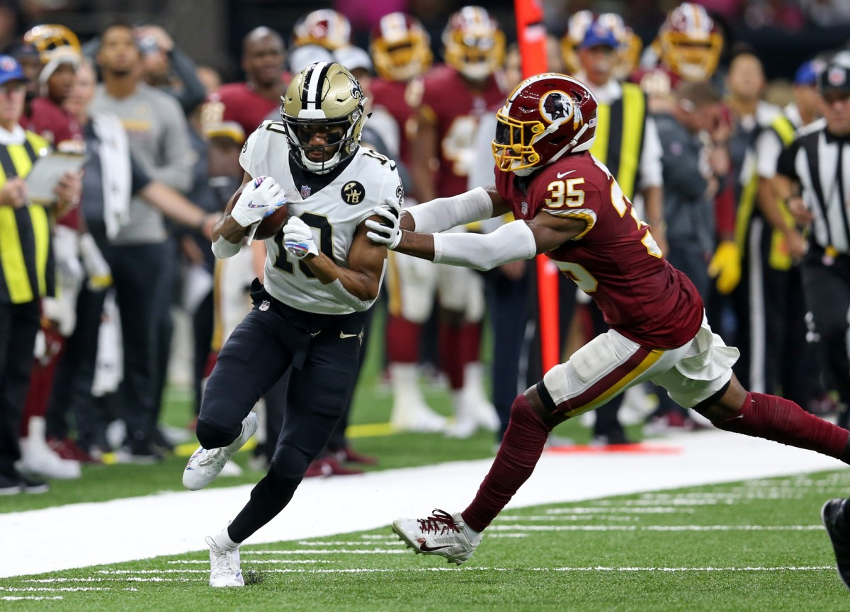 New Orleans receiver Tre'Quan Smith (10) runs for a touchdown against Redskins safety Montae Nicholson (35). Saints quarterback Drew Brees (not pictured) set the all-time NFL passing yardage mark on this play. Mandatory Credit: Chuck Cook-USA TODAY