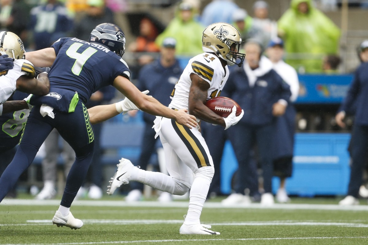 New Orleans Saints receiver Deonte Harris (11) returns a punt for a touchdown against the Seattle Seahawks. Mandatory Credit: Joe Nicholson-USA TODAY Sports