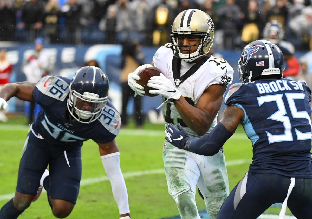New Orleans receiver Michael Thomas (13) breaks the record for receptions in a season with this touchdown reception against the Tennessee Titans. Mandatory Credit: Christopher Hanewinckel-USA TODAY