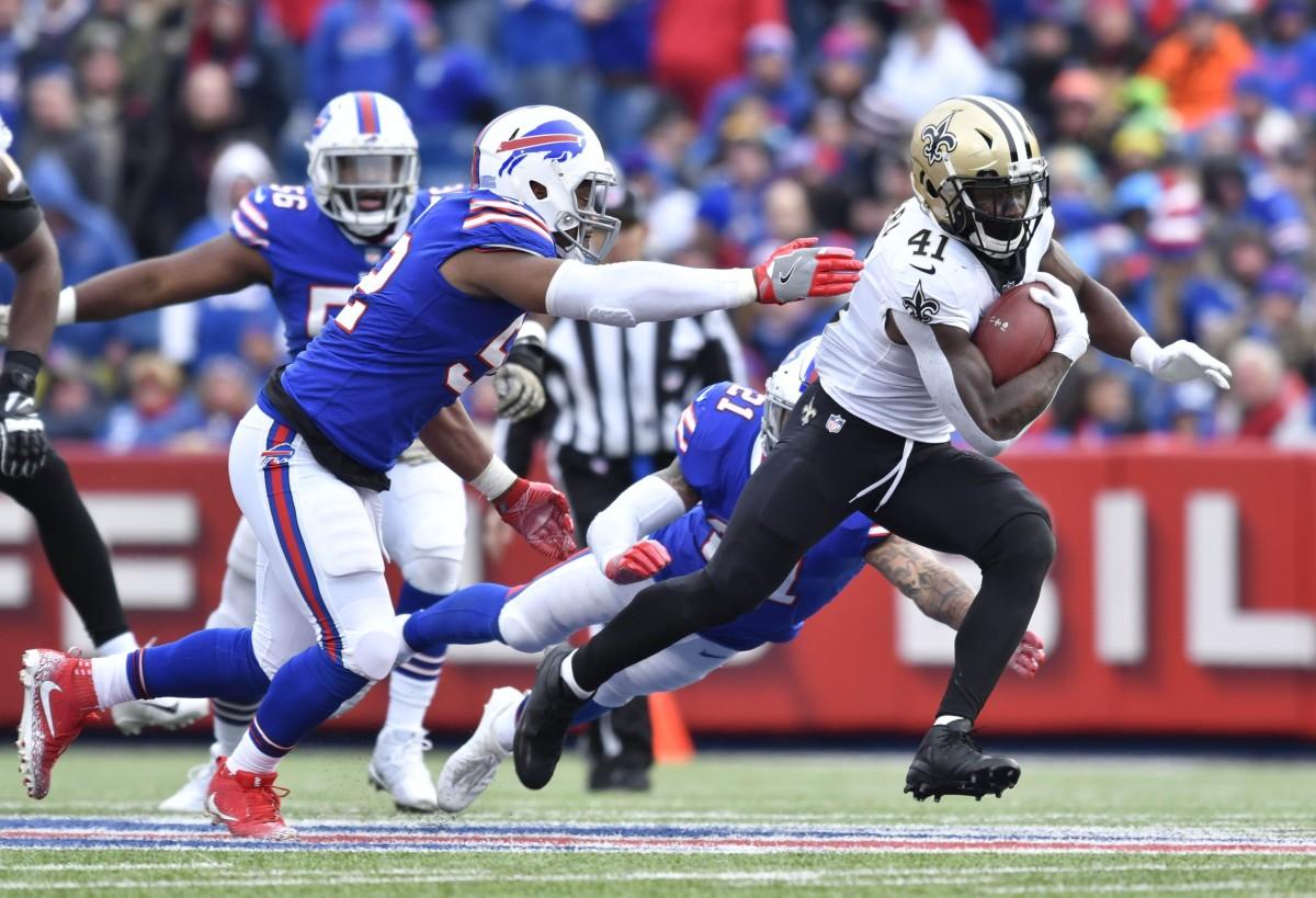 New Orleans Saints running back Alvin Kamara (41) runs past Buffalo linebacker Preston Brown (52). Mandatory Credit: Mark Konezny-USA TODAY Sports