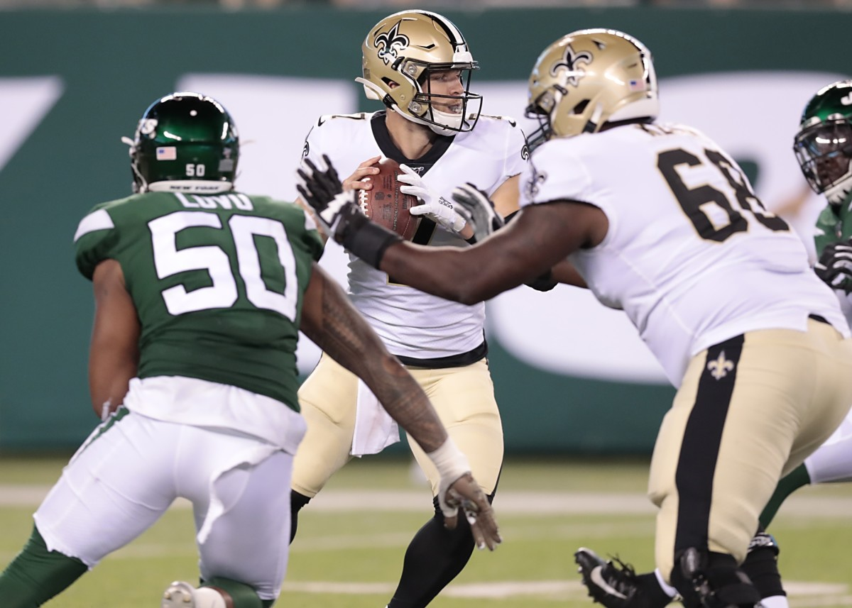 Saints quarterback Taysom Hill (7) drops back to pass as Jets linebacker Frankie Luvu (50) is blocked by tackle Derrick Kelly (68). Mandatory Credit: Vincent Carchietta-USA TODAY