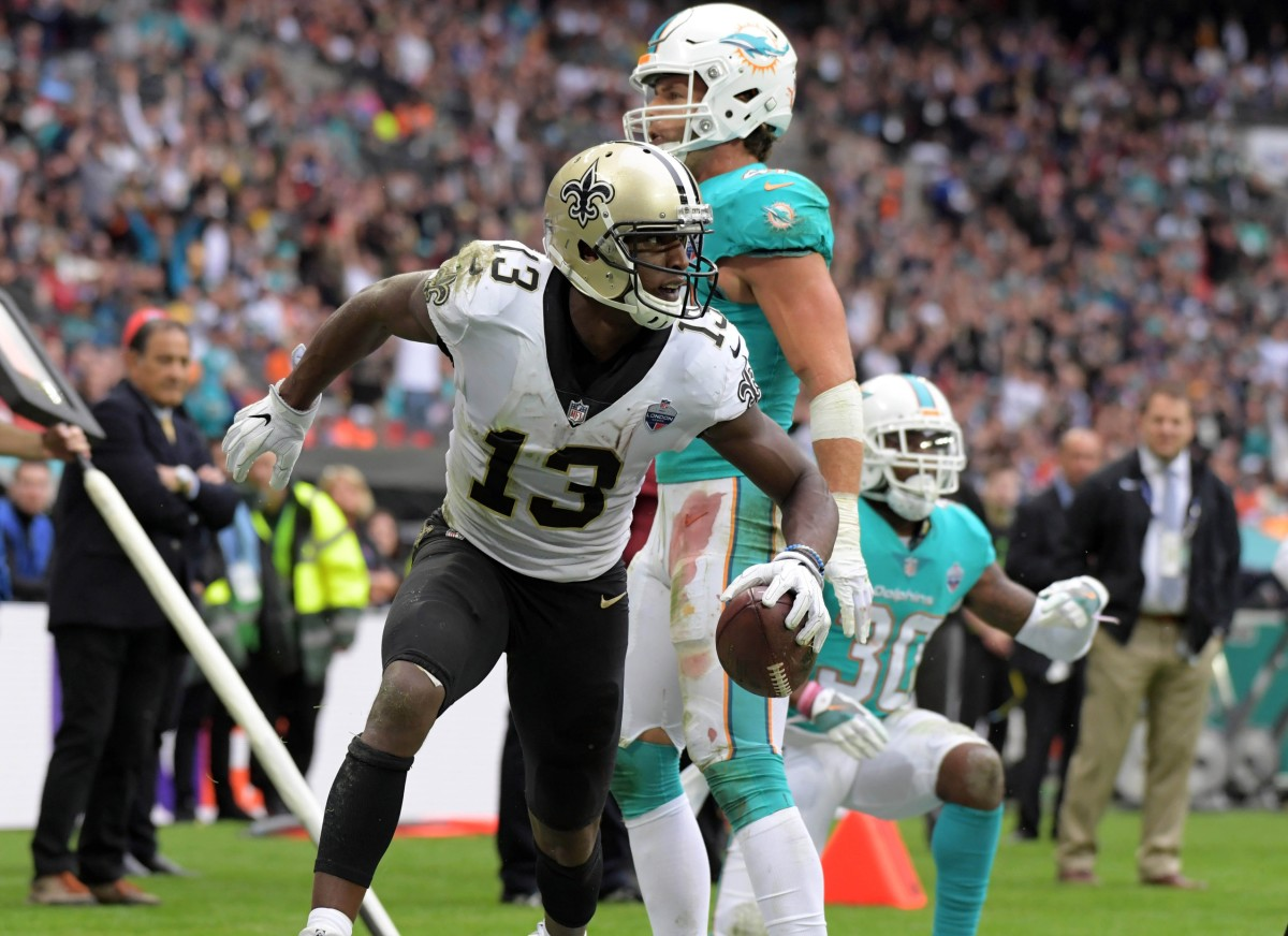 New Orleans Saints wide receiver Michael Thomas (13) celebrates after scoring on a touchdown reception against the Miami Dolphins. Mandatory Credit: Kirby Lee-USA TODAY Sports