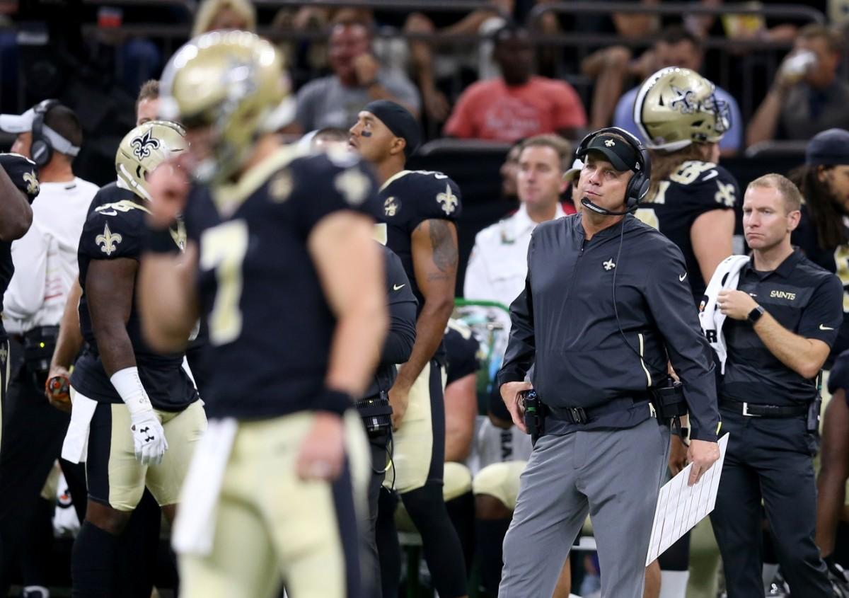 New Orleans Saints head coach Sean Payton looks at quarterback Taysom Hill (7) against the Arizona Cardinals. Mandatory Credit: Chuck Cook-USA TODAY Sports