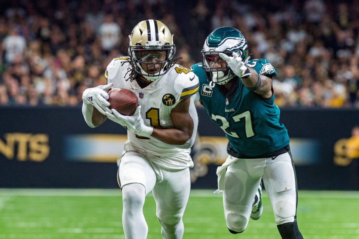New Orleans Saints running back Alvin Kamara (41) runs the ball against Eagles safety Malcolm Jenkins (27). Mandatory Credit: Scott Clause/The Advertiser via USA TODAY NETWORK