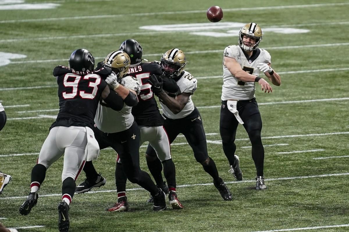 New Orleans Saints quarterback Taysom Hill (7) passes against the Atlanta Falcons. Mandatory Credit: Dale Zanine-USA TODAY Sports