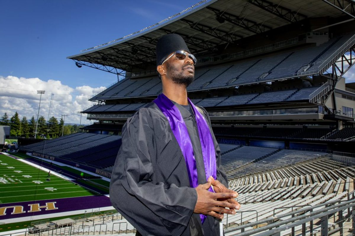Doug Wrenn, former UW basketball player, is a graduate two decades later.