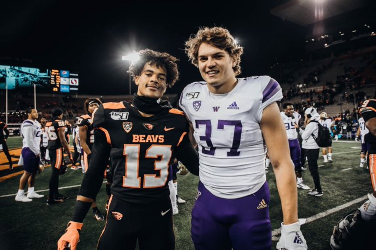 Jesiah Irish and Jack Westover, former Mount Si High teammates, take a photo after the UW-OSU game.