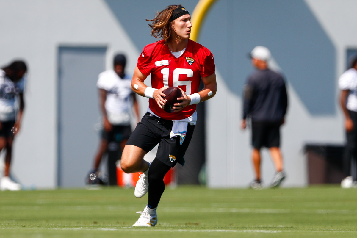 Jun 14, 2021; Jacksonville, Florida, USA; Jacksonville Jaguars quarterback Trevor Lawrence (16) participates in drills during minicamp at Dream Finders Homes practice complex Mandatory Credit: Nathan Ray Seebeck-USA TODAY Sports