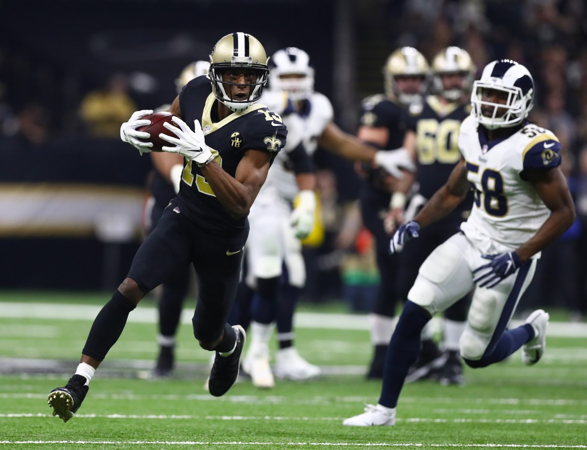 New Orleans Saints receiver Michael Thomas (13) runs after a reception against the Los Angeles Rams. Mandatory Credit: Matthew Emmons-USA TODAY Sports