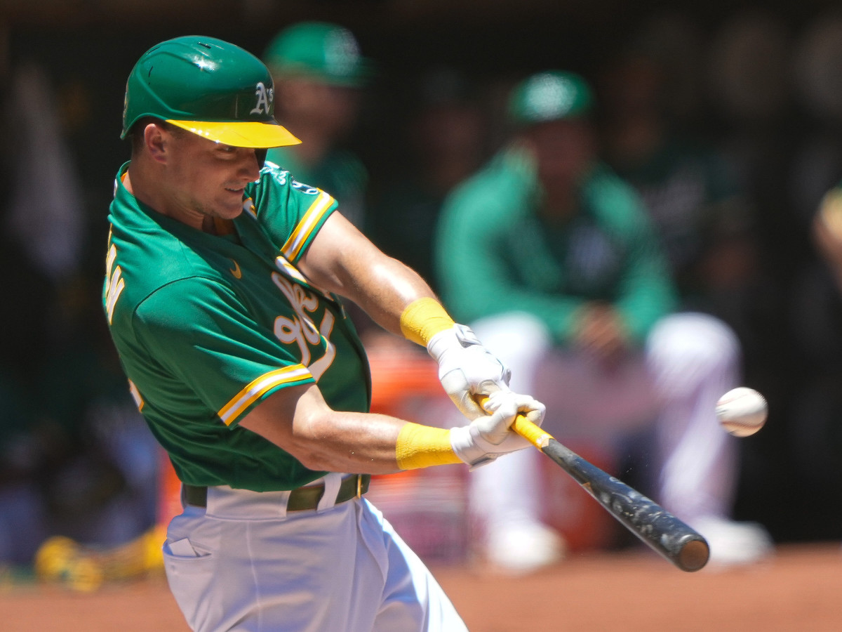 Oakland Athletics third baseman Matt Chapman (26) hits a solo home run during the first inning against the Kansas City Royals at RingCentral Coliseum.