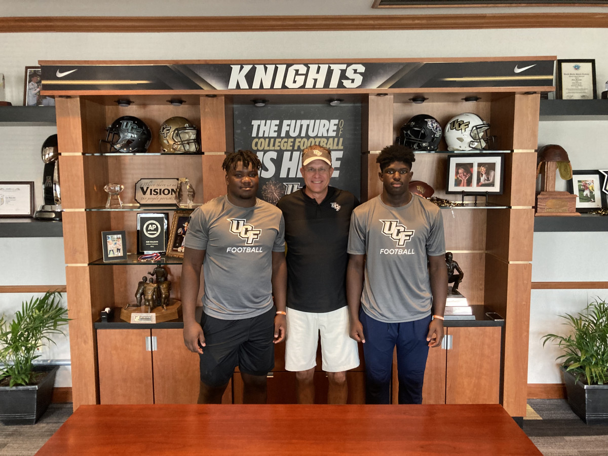 Tavaras Capers and Daylen Russell with Gus Malzahn