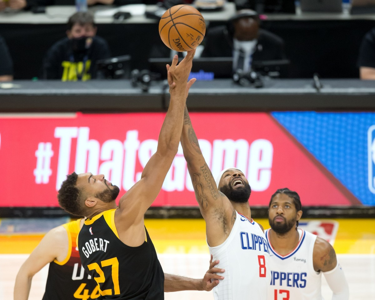 Rudy Gobert (27) and Marcus Morris (8) tip things off in game five on Wednesday night