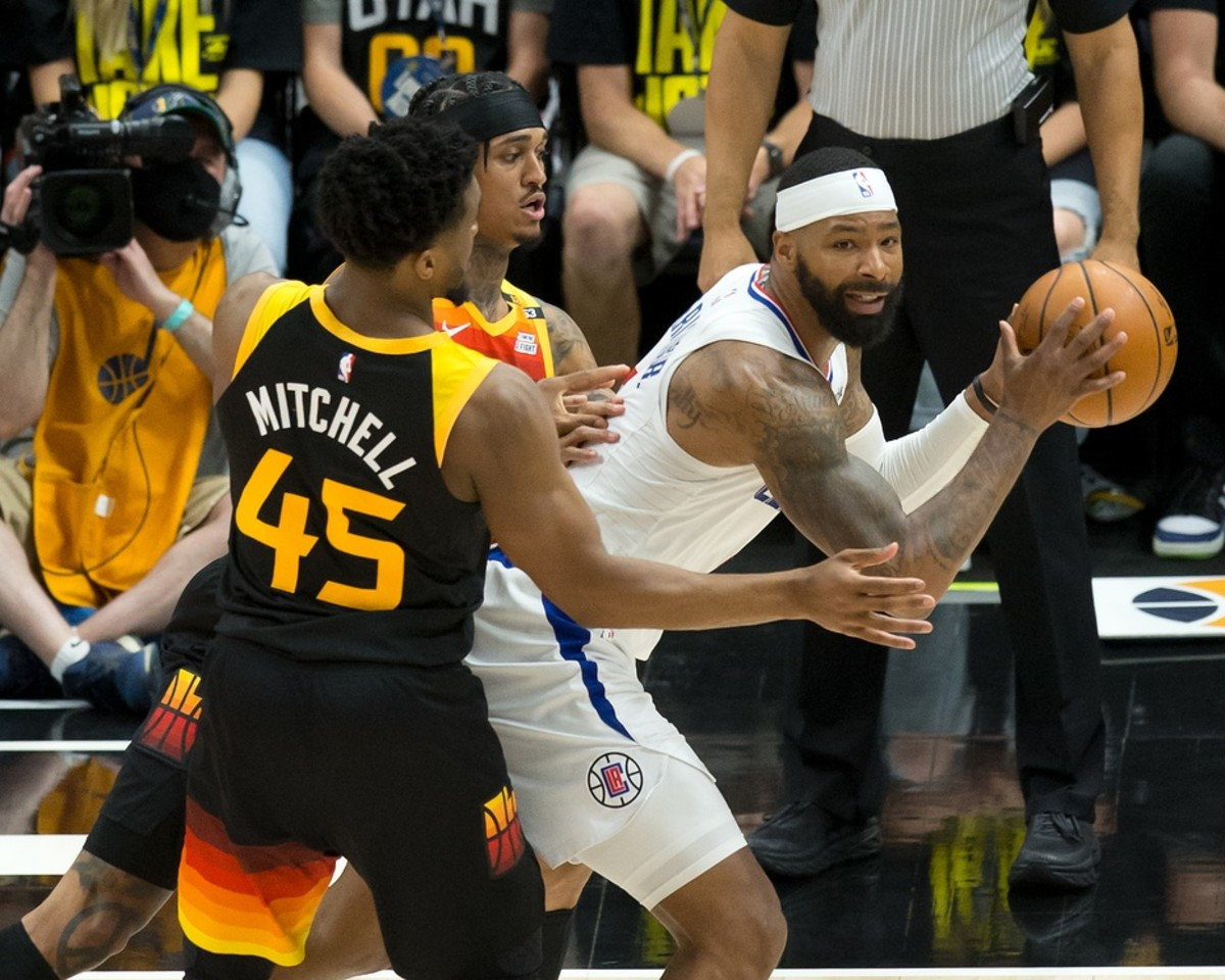 Donovan Mitchell (45) and Jordan Clarkson (00) try and trap Marcus Morris (8)