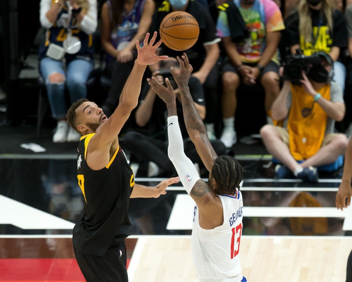 Rudy Gobert (27) tries to block a shot by Paul George (13)