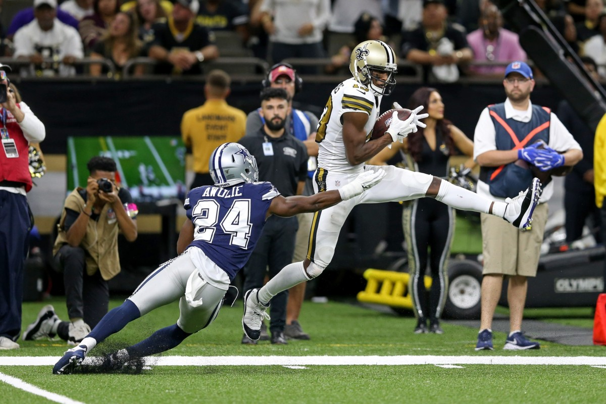 New Orleans Saints receiver Michael Thomas (13) makes a catch in front of Cowboys cornerback Chidobe Awuzie (24). Mandatory Credit: Chuck Cook-USA TODAY