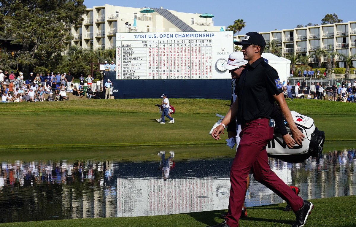 Mackenzie Hughes walks to the 18th green during the U.S. Open's third round at Torrey Pines Golf Course.