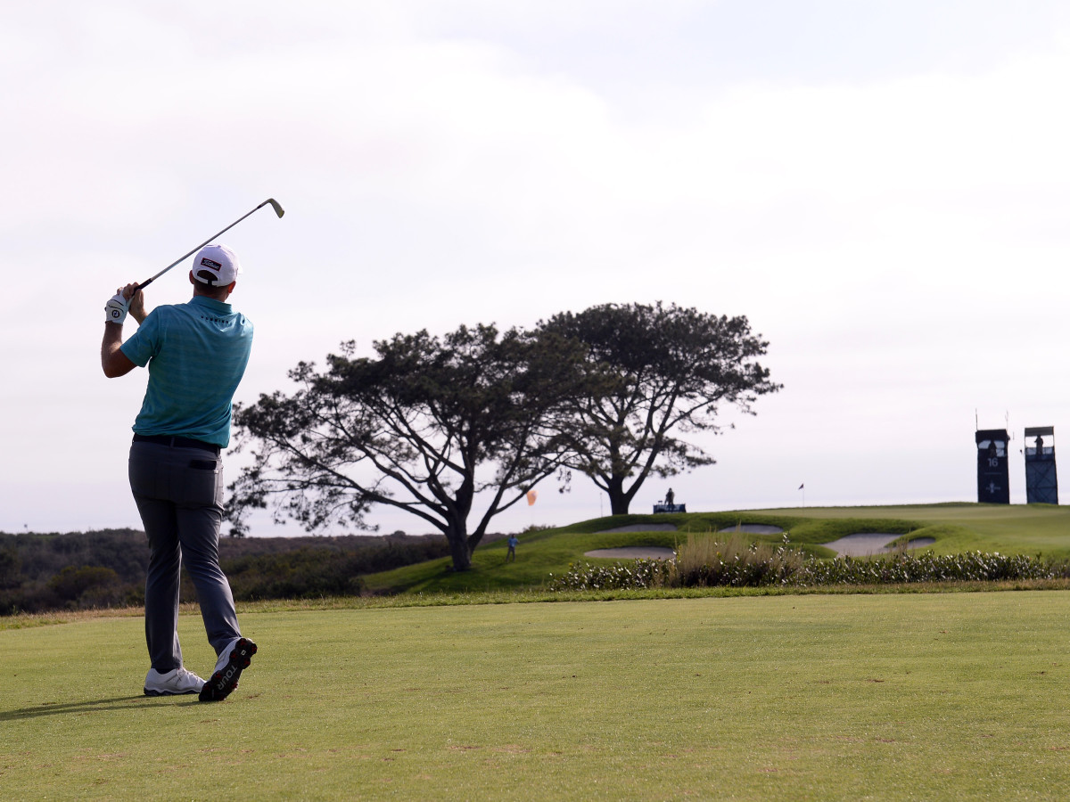 Russell Henley plays his shot from the 16th tee during the third round of the U.S. Open golf tournament at Torrey Pines Golf Course.