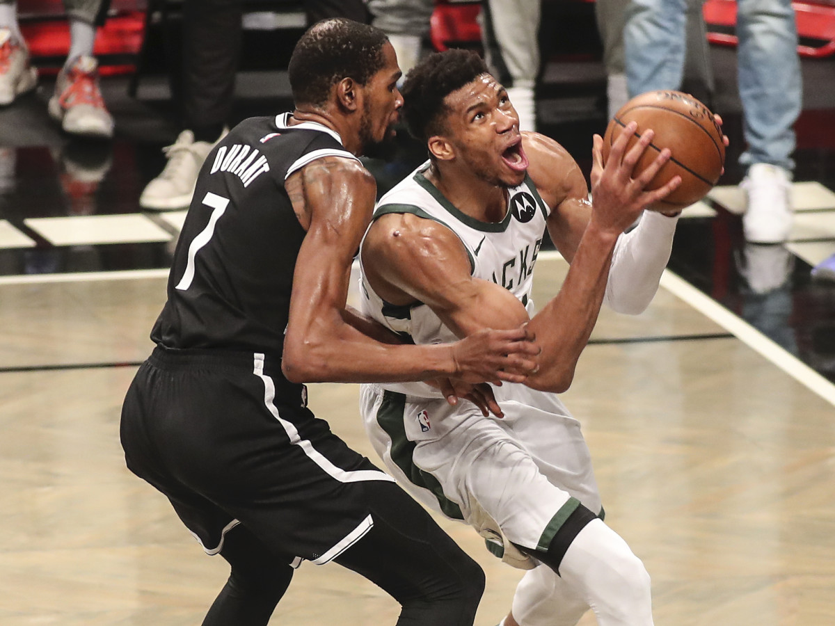 Milwaukee Bucks forward Giannis Antetokounmpo (34) drives past Brooklyn Nets forward Kevin Durant (7) in the third quarter during game seven in the second round of the 2021 NBA Playoffs