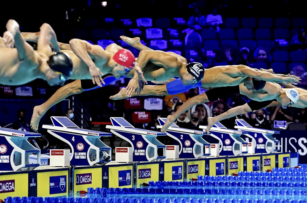 Nathan Adrian, center, leaves the blocks in the 50 free final