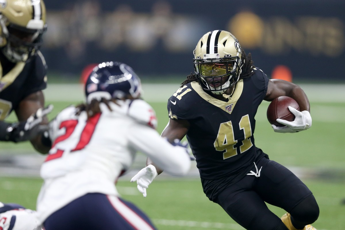 New Orleans Saints running back Alvin Kamara (41) defended by Houston Texans cornerback Bradley Roby (21). Mandatory Credit: Chuck Cook-USA TODAY Sports