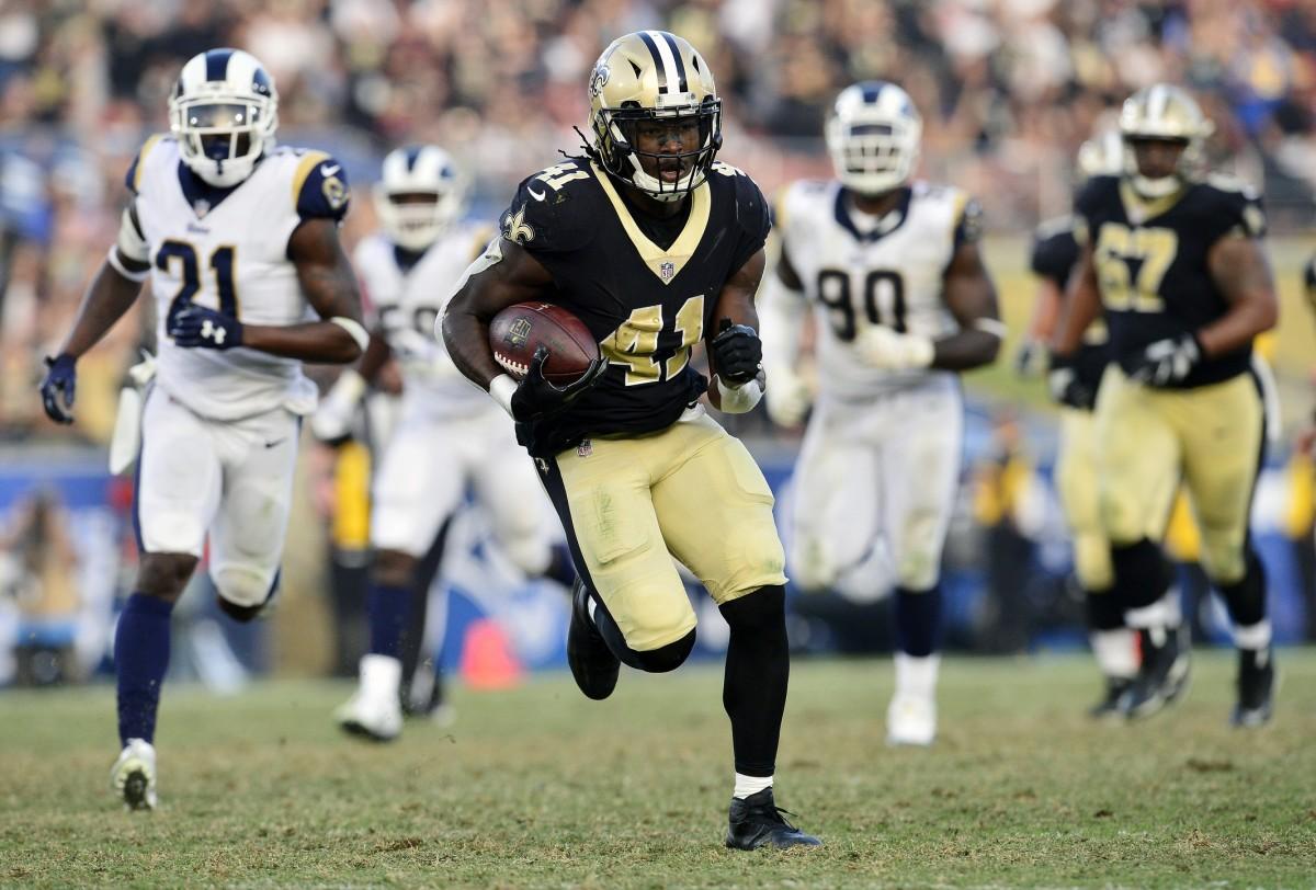 New Orleans Saints running back Alvin Kamara (41) runs against the Los Angeles Rams defense. Mandatory Credit: Gary A. Vasquez-USA TODAY