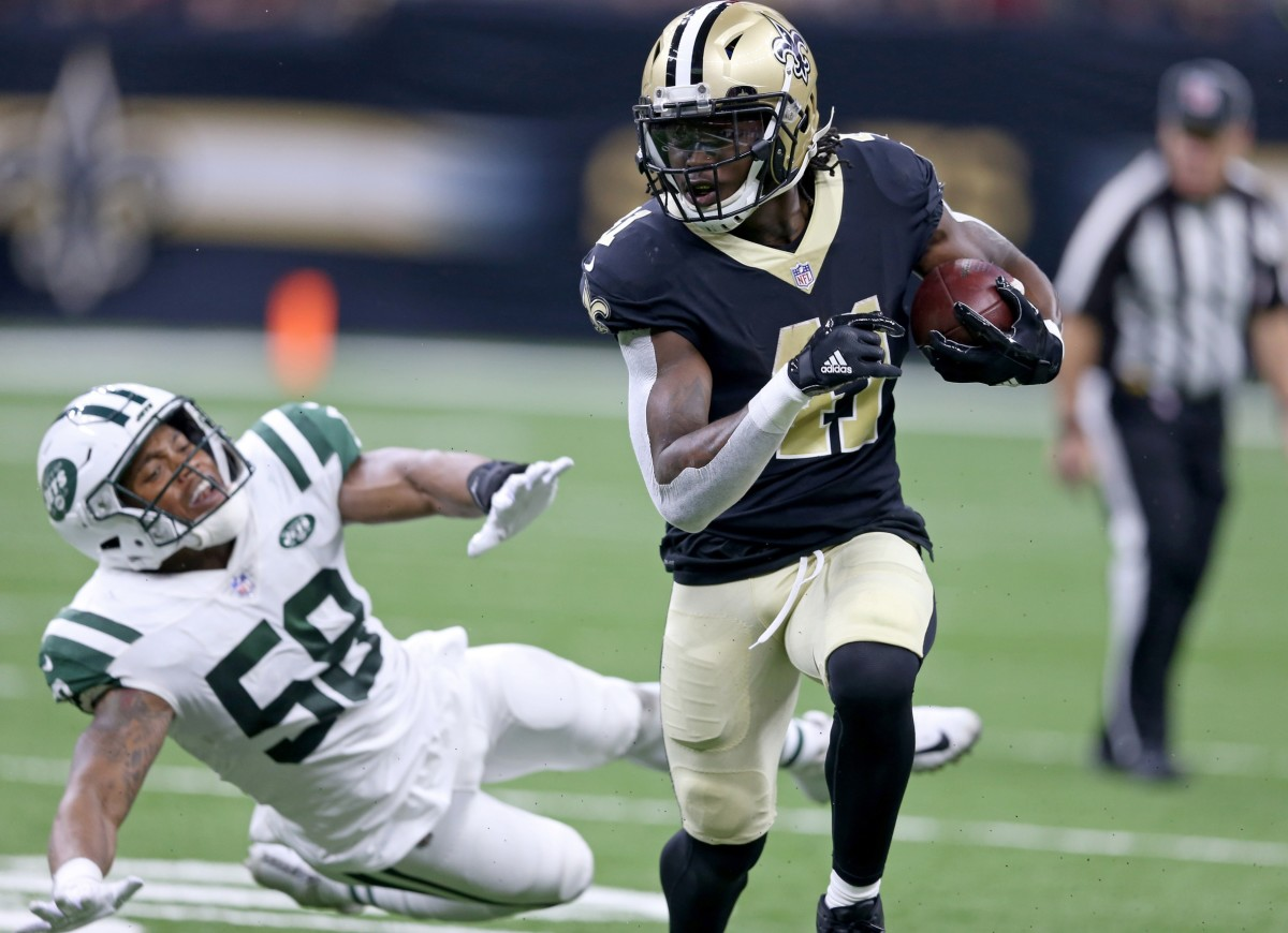 New Orleans Saints running back Alvin Kamara (41) is pursued by Jets linebacker Darron Lee (58). Mandatory Credit: Chuck Cook-USA TODAY