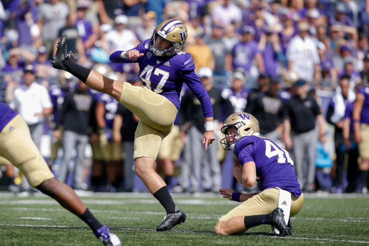 Peyton Henry follows through on a Husky field goal.