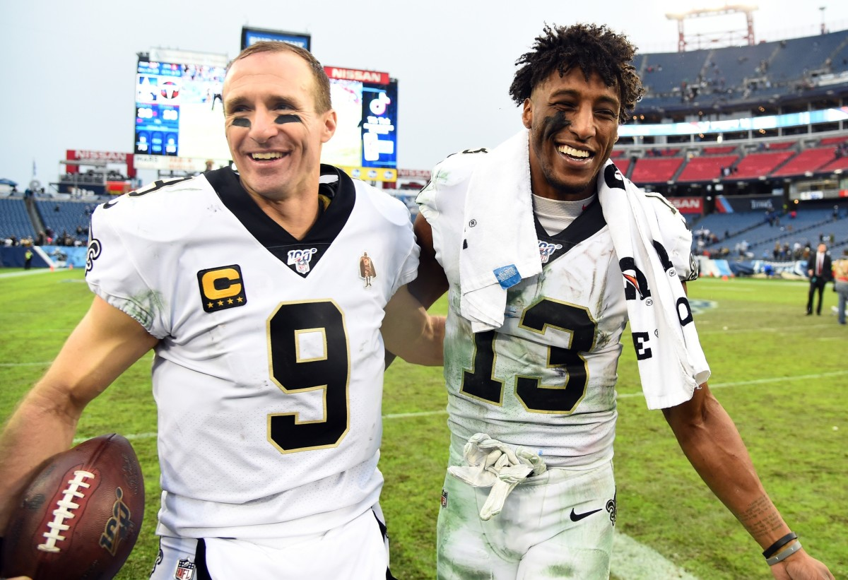 New Orleans Saints wide receiver Michael Thomas (13) and New Orleans Saints quarterback Drew Brees (9). Mandatory Credit: Christopher Hanewinckel-USA TODAY