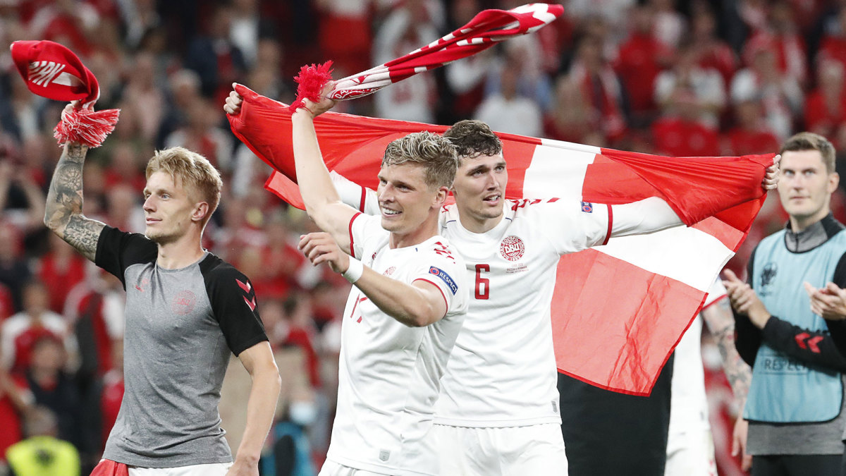Denmark players celebrate a win over Russia.