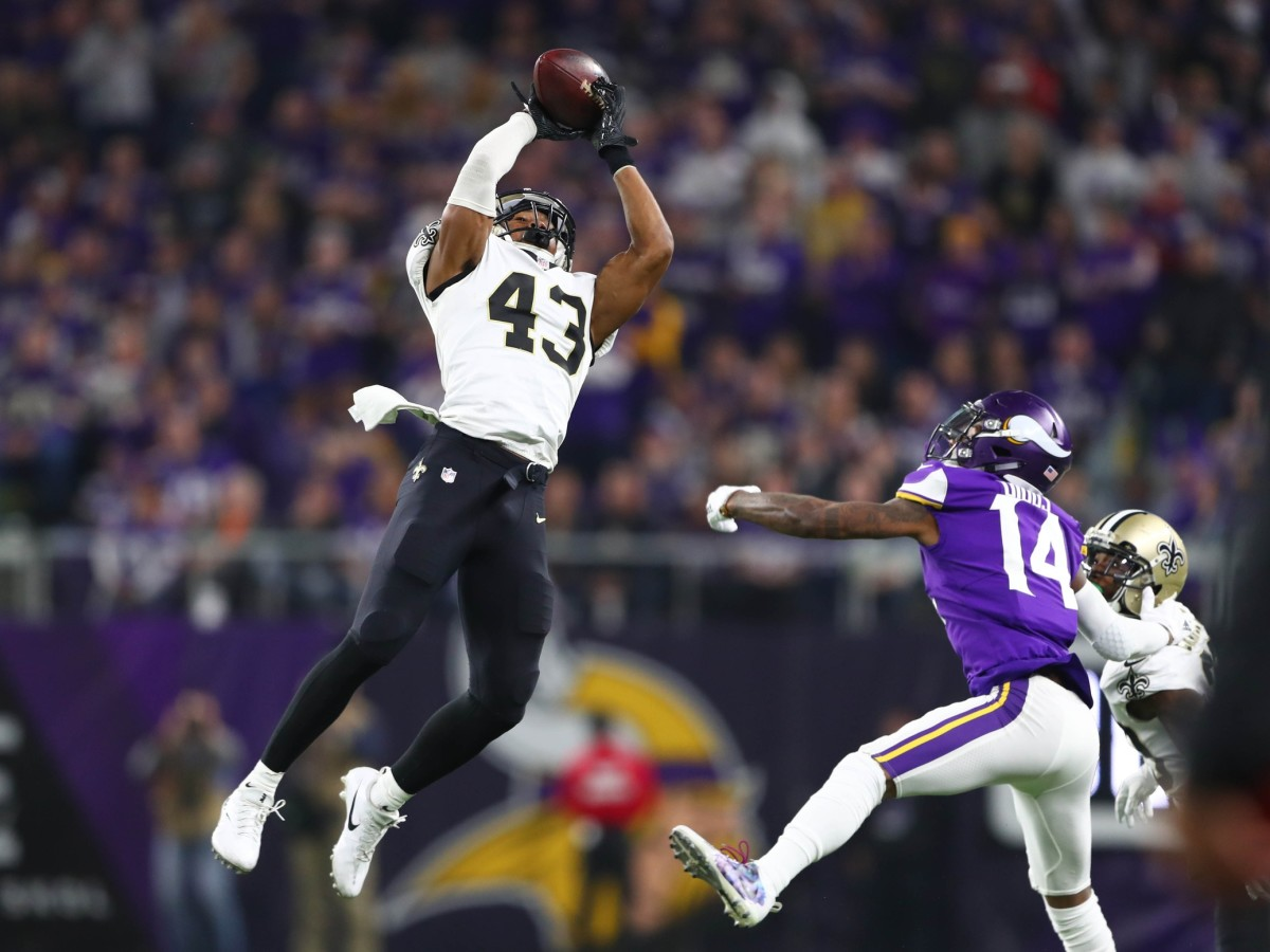 New Orleans Saints free safety Marcus Williams (43) intercepts a pass intended for Vikings receiver Stefon Diggs (14) . Mandatory Credit: Mark J. Rebilas-USA TODAY