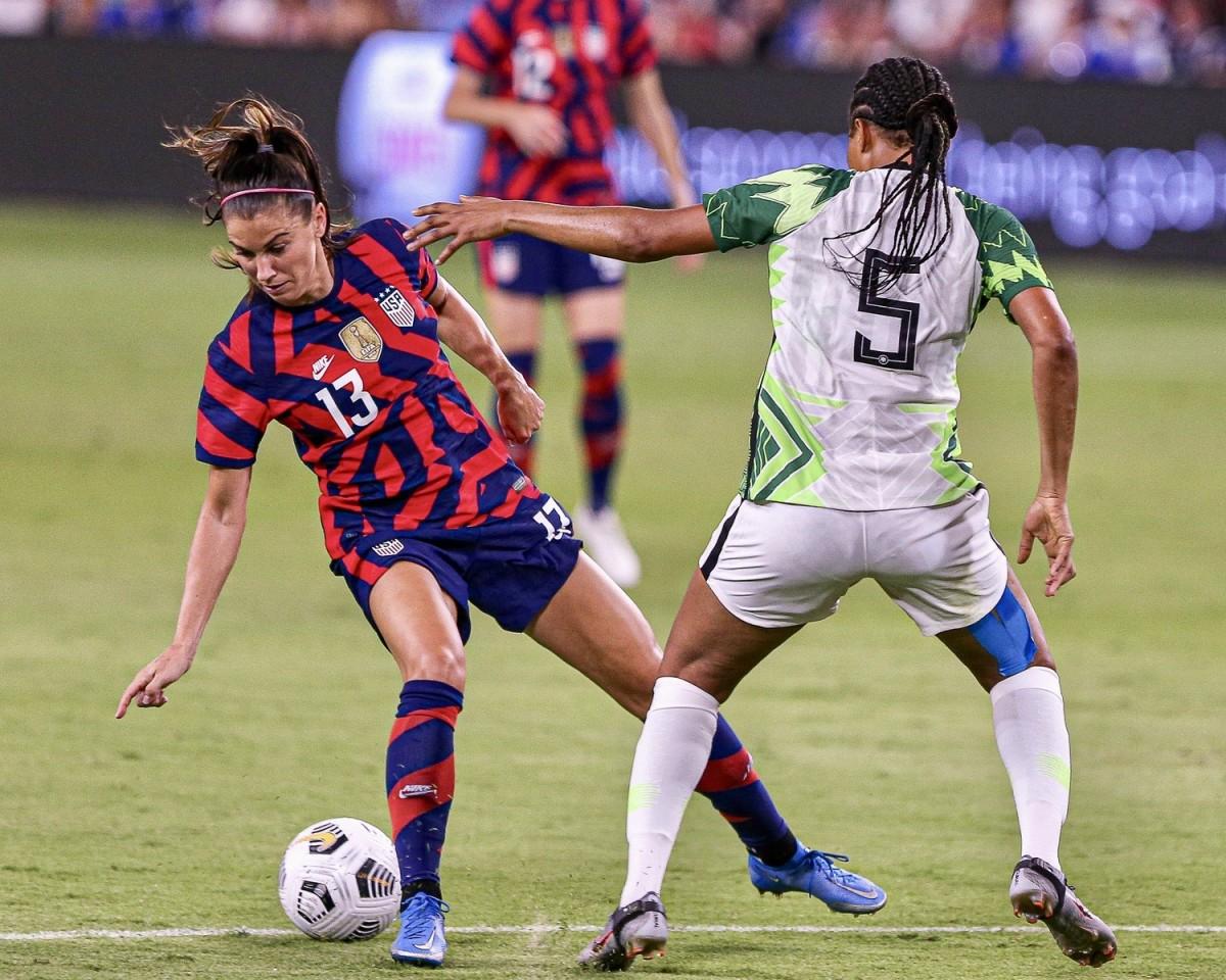 Alex Morgan, left, in action against Nigeria this year
