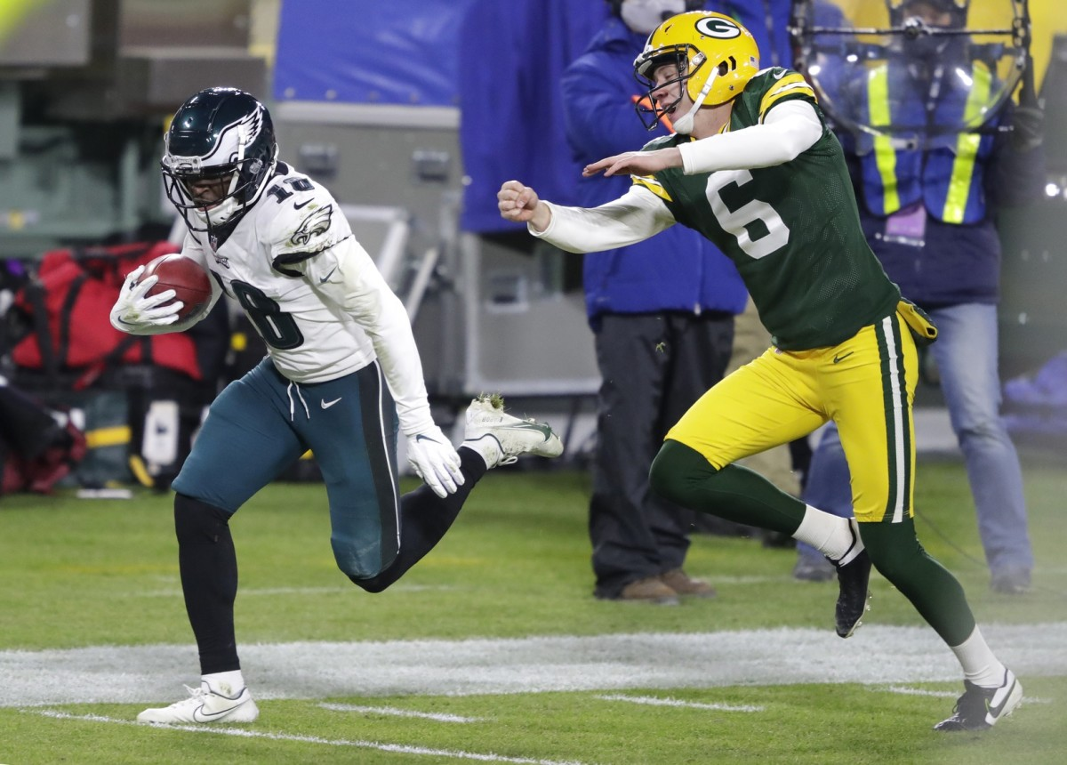 Jalen Reagor returns a punt 73 yards for a touchdown against the Packers on Dec. 6, 2020
