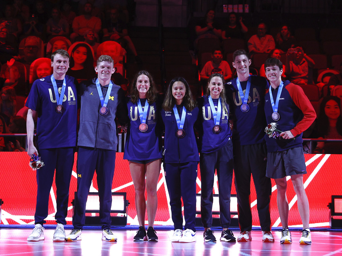 Brooke Forde (third from left) poses with teammates, from left: Bowe Becker, Patrick Callan, Bella Sims, Catie Deloof, Hunter Armstrong and Jake Mitchell during their medal ceremony during the 2021 U.S. Olympic Team Swimming Trials.