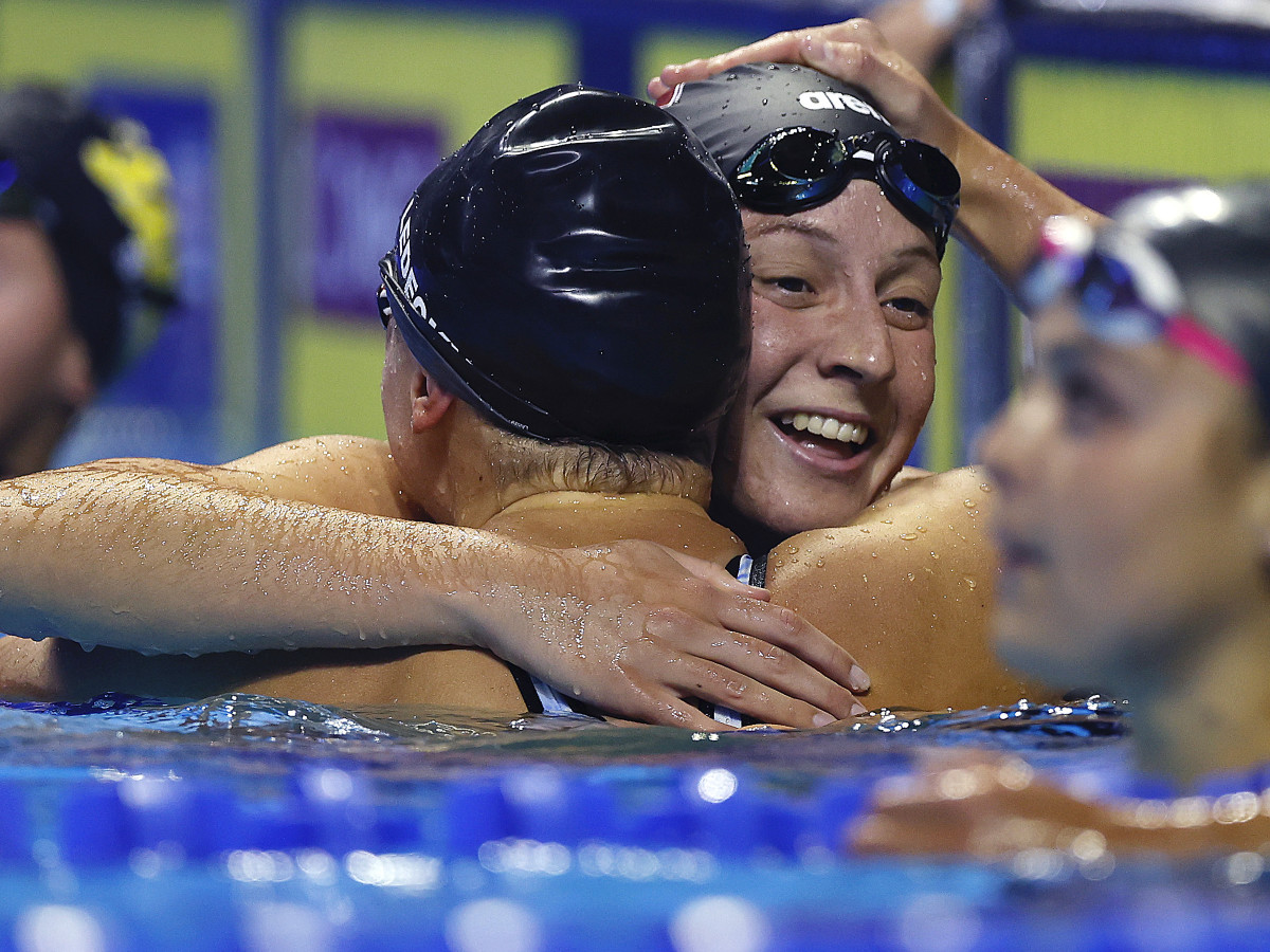 Brooke Forde embraces Katie Ledecky after competing in the Women's 200m freestyle final of the 2021 U.S. Olympic Team Swimming Trials.