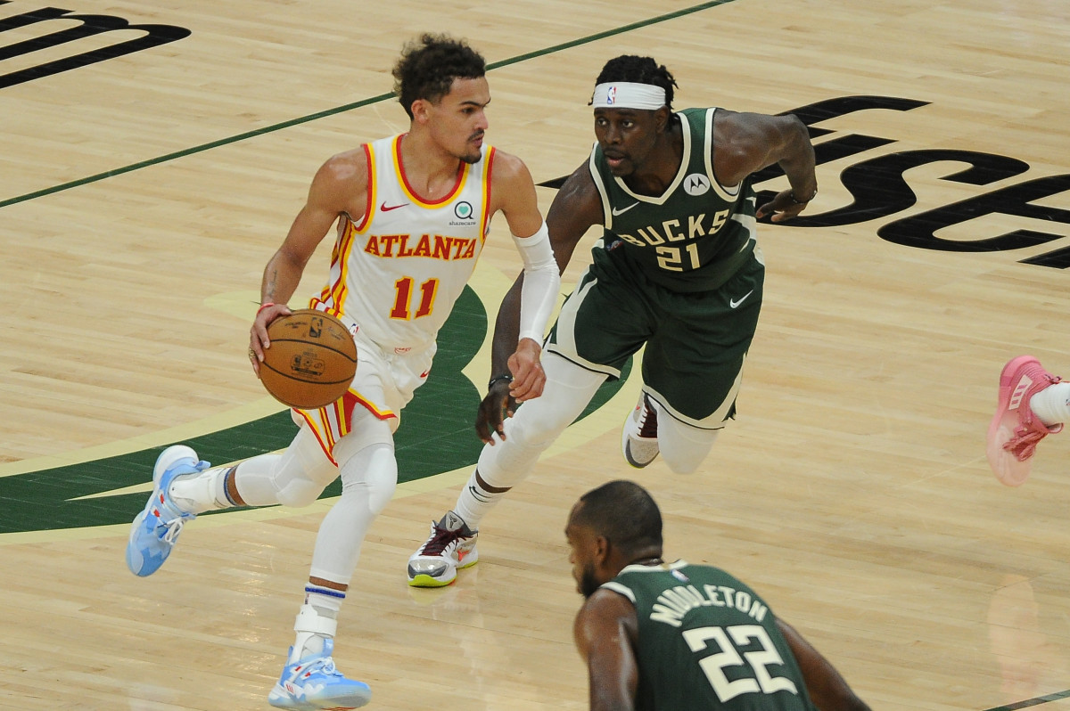 Jun 23, 2021; Milwaukee, Wisconsin, USA; Atlanta Hawks guard Trae Young (11) drives against Milwaukee Bucks guard Jrue Holiday (21) in the third quarter during game one of the Eastern Conference Finals for the 2021 NBA Playoffs at Fiserv Forum. Mandatory Credit: Michael McLoone-USA TODAY Sports
