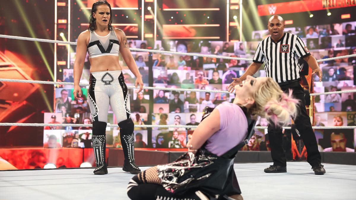 Shayna Baszler stares at a cackling Alexa Bliss