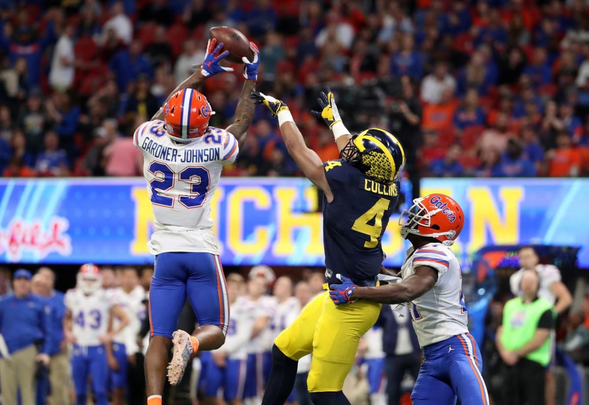 Florida Gators defensive back Chauncey Gardner-Johnson (23) intercepts a pass for Michigan Wolverines receiver Nico Collins (4). Mandatory Credit: Jason Getz-USA TODAY