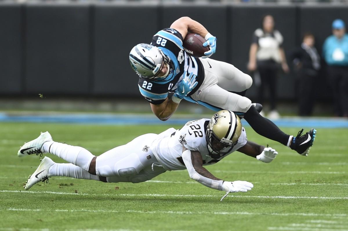 Carolina running back Christian McCaffrey (22) is tackled by Saints defensive back Chauncey Gardner-Johnson (22). Mandatory Credit: Bob Donnan-USA TODAY Sports