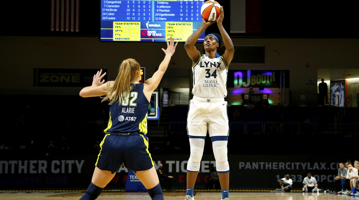 Sylvia Fowles shooting the basketball over a Dallas Wings player