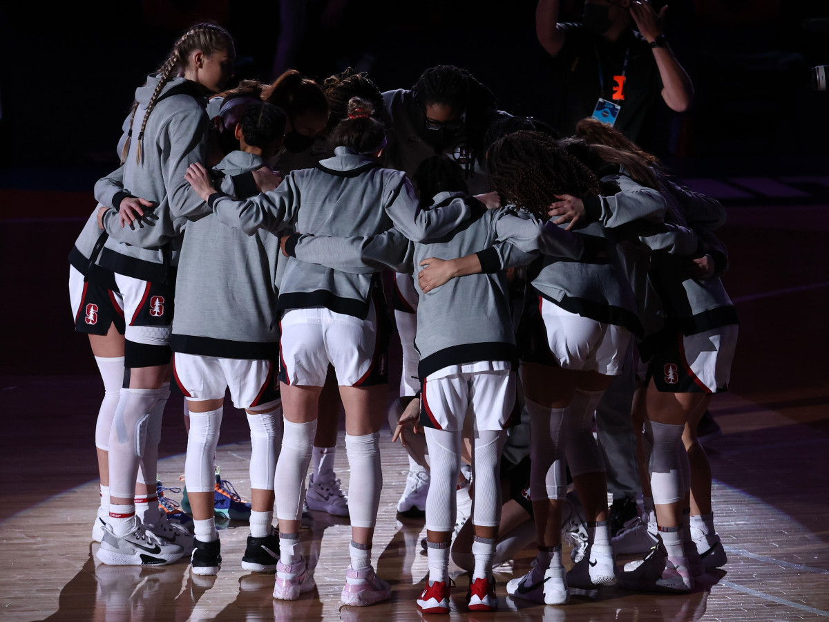 Stanford Cardinal players huddle on the court prior to their game against the Arizona Wildcats in the national championship game of the women's Final Four of the 2021 NCAA Tournament at Alamodome.