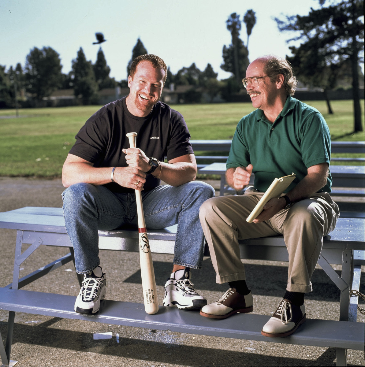 Kindred and Mark McGwire, for a Sporting News story, in 1997.