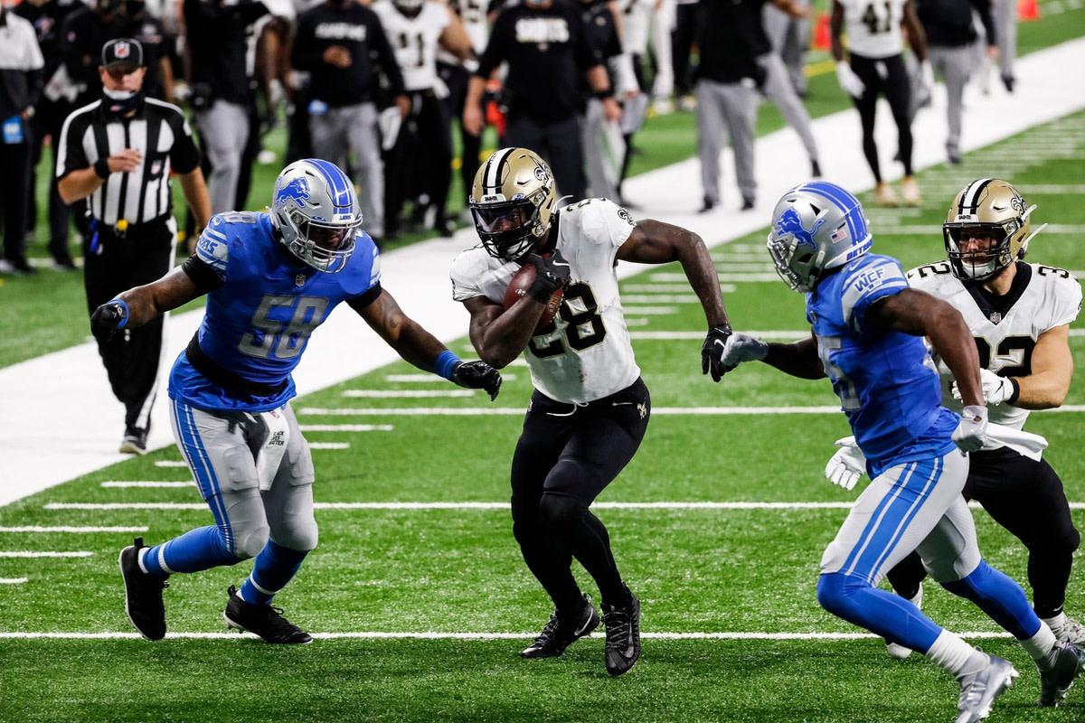 New Orleans Saints running back Latavius Murray runs against Detroit linebacker Jamie Collins (58).© Junfu Han via Imagn Content Services, LLC