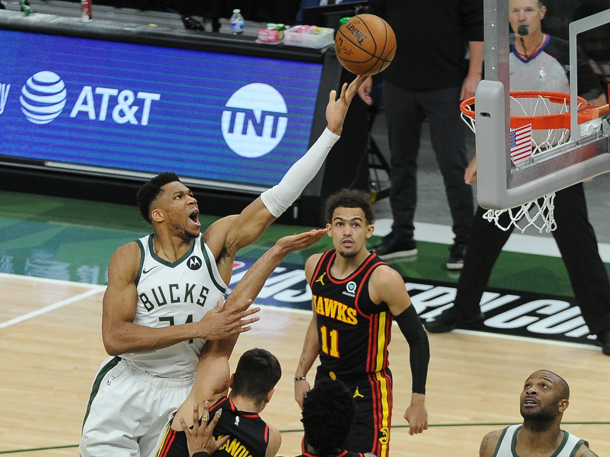 Milwaukee Bucks forward Giannis Antetokounmpo (34) shoots the ball over Atlanta Hawks guard Bogdan Bogdanovic (13) in the first quarter during game two of the Eastern Conference Finals