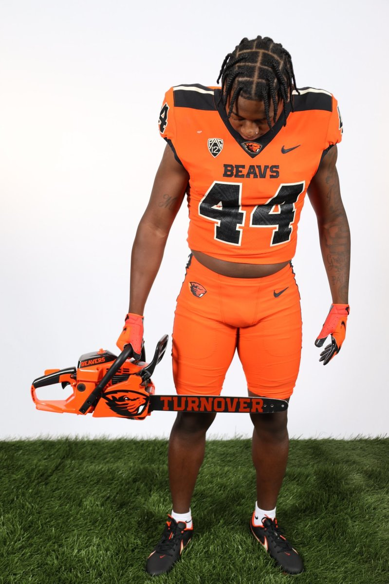 Melvin Jordan poses with the turnover chainsaw during a photoshoot in Corvallis.