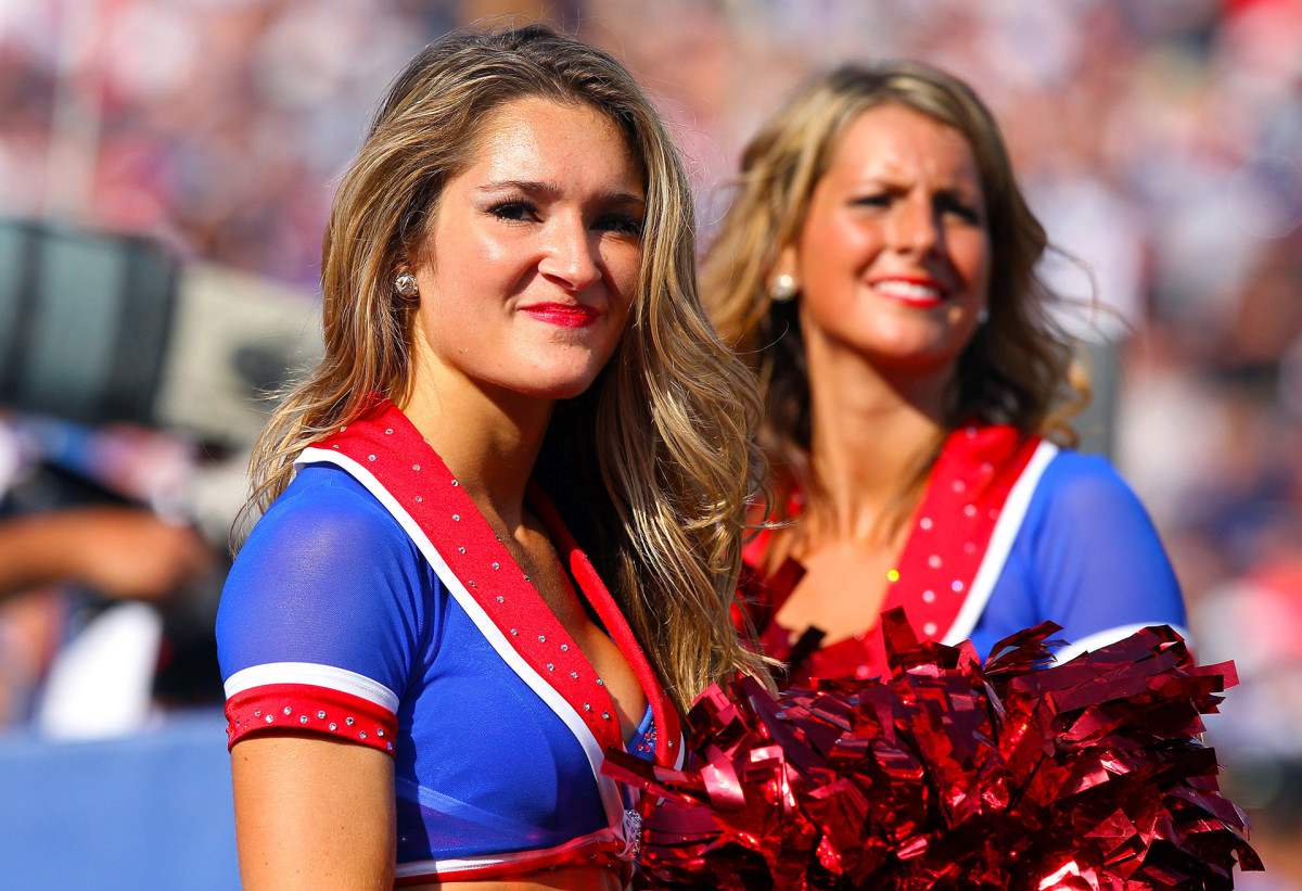 Two members of the Buffalo Jills cheerleaders during a game in 2011