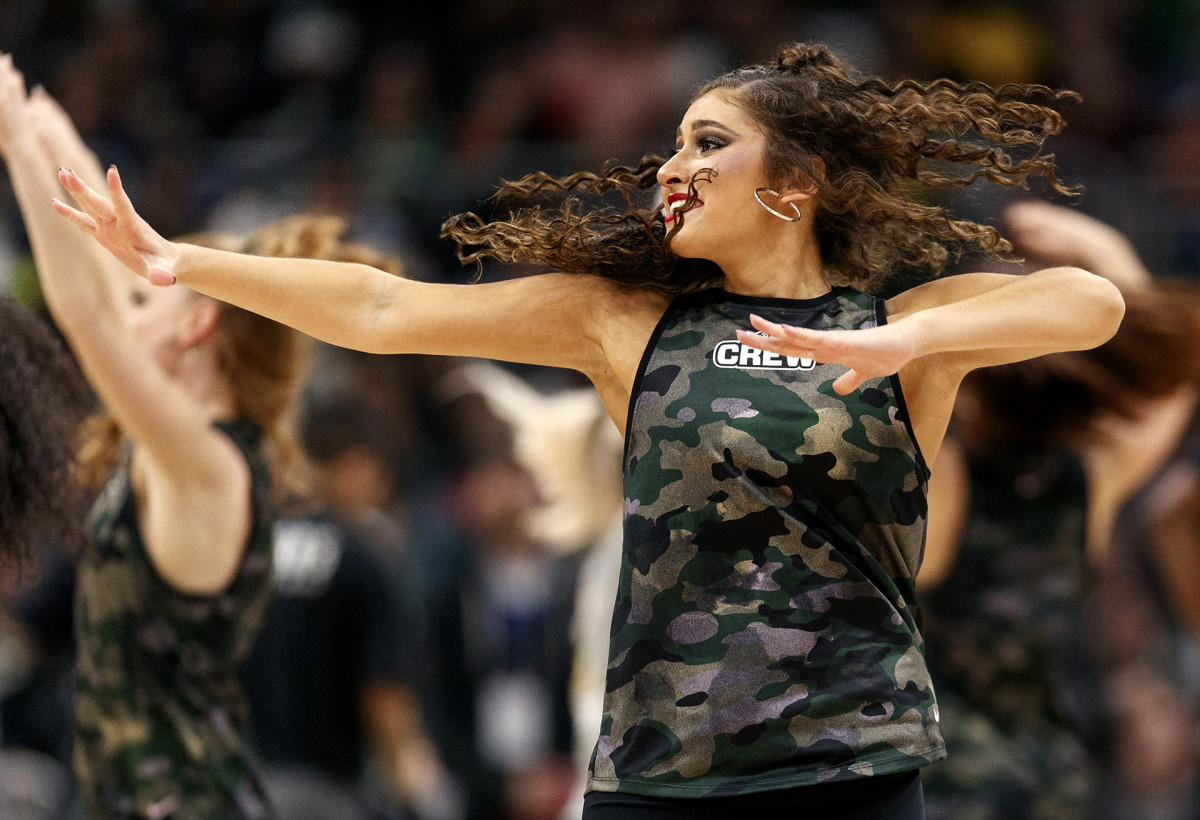 A dancer for the Milwaukee Bucks' 414 Crew performs during a game